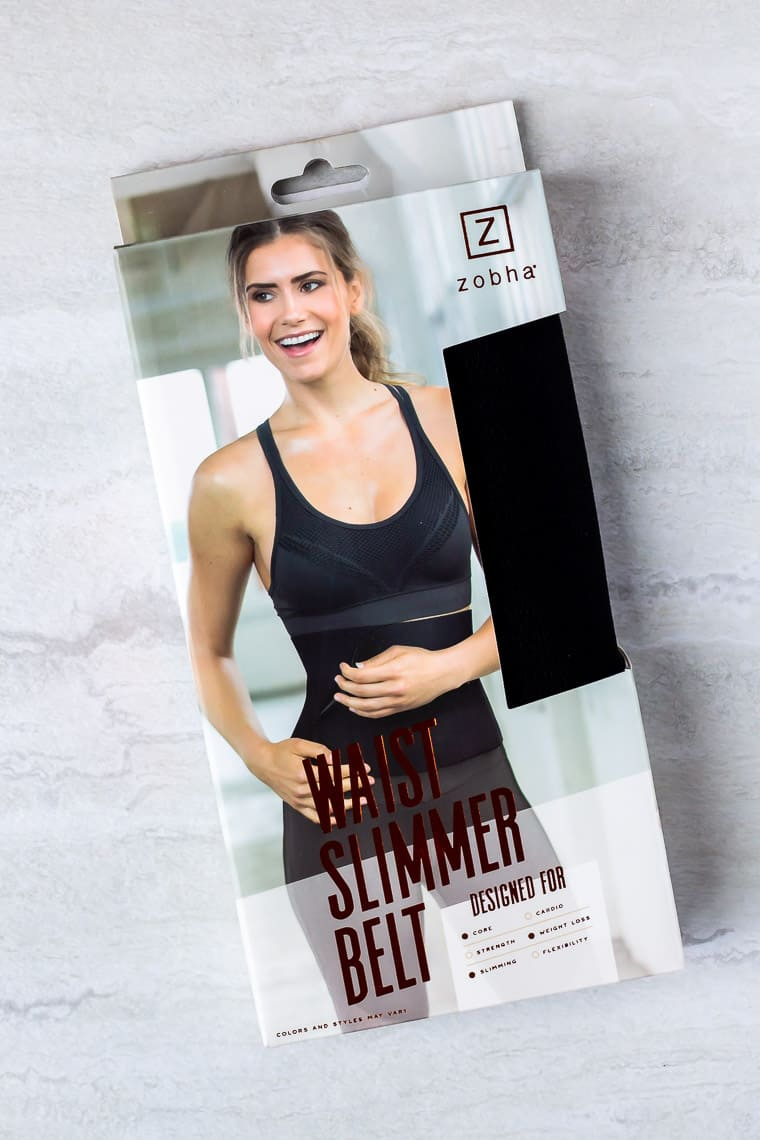 Zohba waist trainer in its packaging over a white background