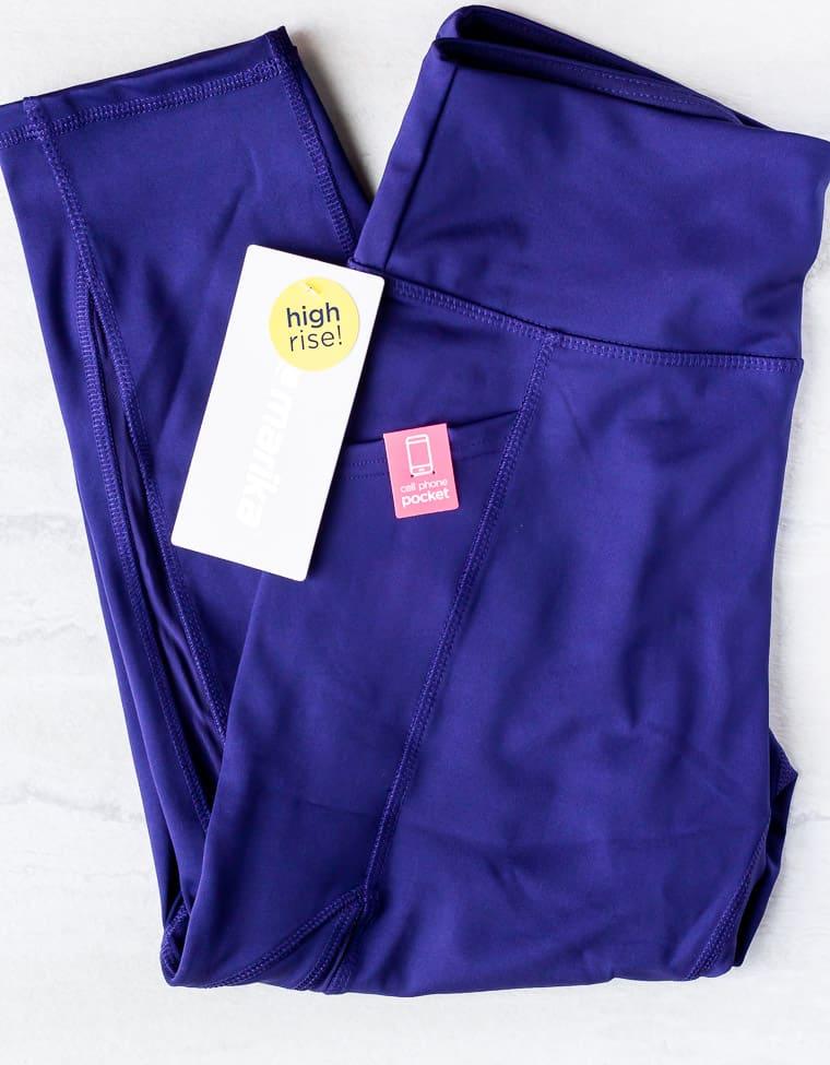 Dark blue Marika leggings from the Calypso set from Ellie on a white background