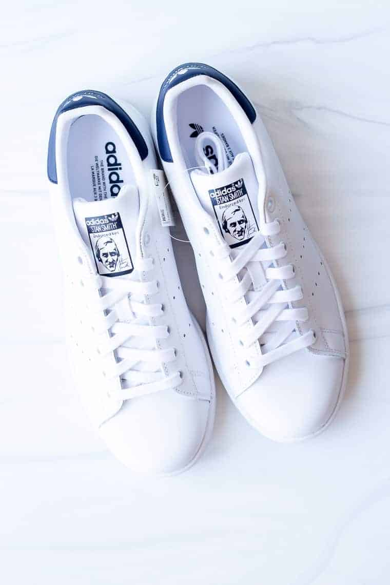 Adidas Stan Smith sneakers in blue and white for women on a white background