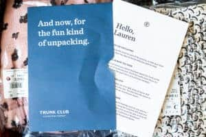 Opened trunk club box with letter and invoice on top of the items