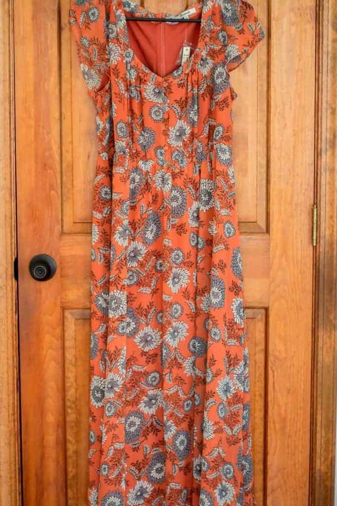 Madewell sheer sleeve button front dress on a hanger in front of a wood door