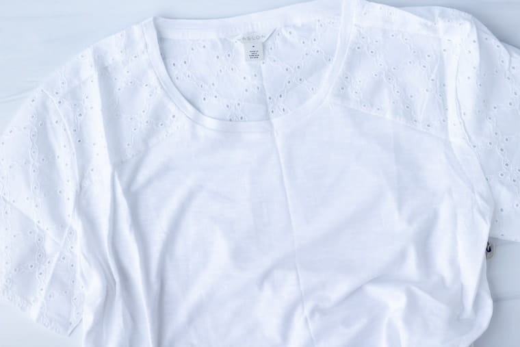 Caslon eyelet detail tee in white on a white background
