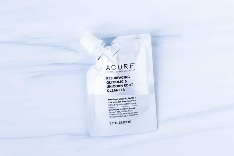 Acure face cleanser sample package on a white background