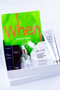 May 2020 Allure subscription box with contents displayed inside over a white background