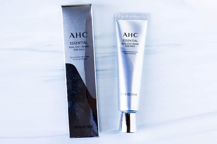 AHC real eye cream for face and the packaging on a white background