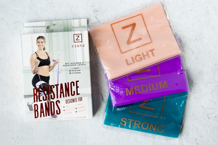 Zobha resistance bands 3 pack with the 3 bands next to the box on a white background