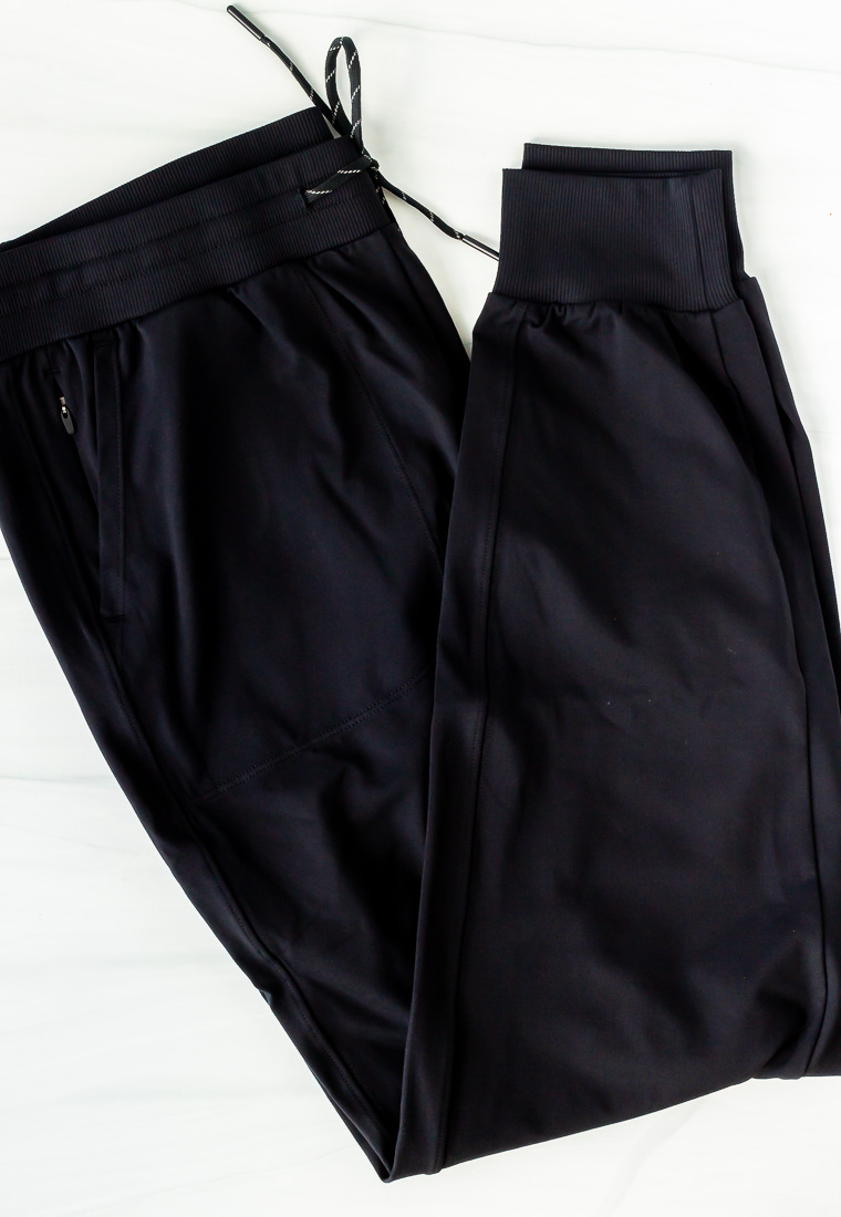 Black joggers folded on a white background