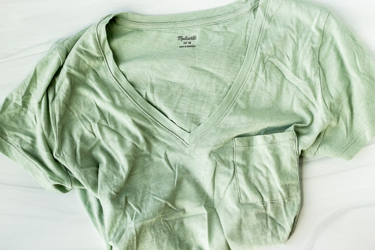 Madewell pocket v-neck in a light green color on a white background