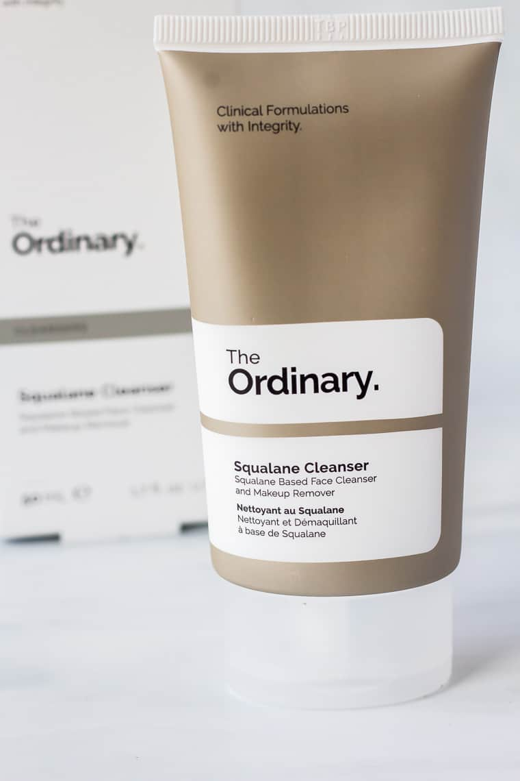 A tube of The Ordinary Squalane Cleanser with the box behind it on a white background