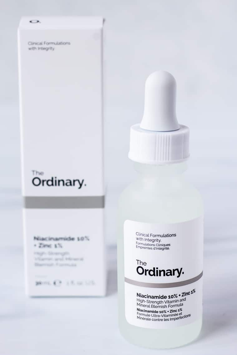 The Ordinary Niacinamide 10% + Zinc 1% with the box behind it with a white background
