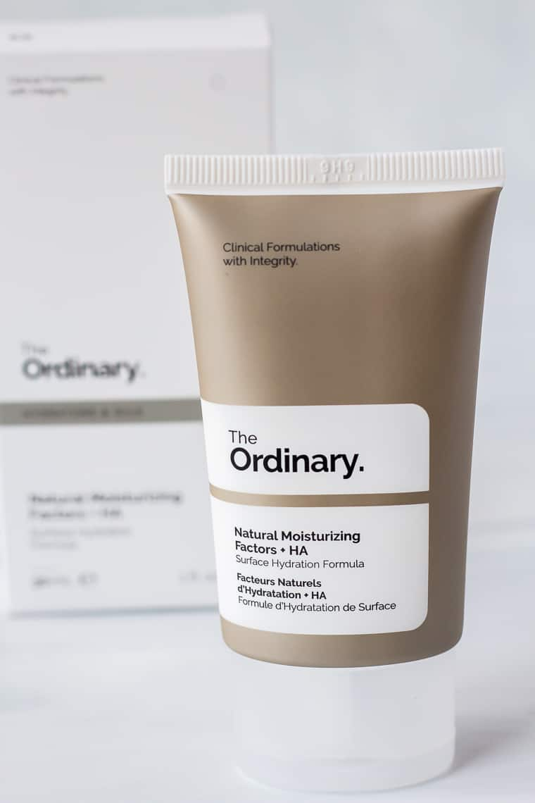 A tube of The Ordinary Natural Moisturizing Factors + HA with the box behind it on a white background