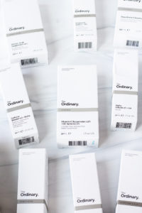 The Ordinary products in boxes laying flat on a white background