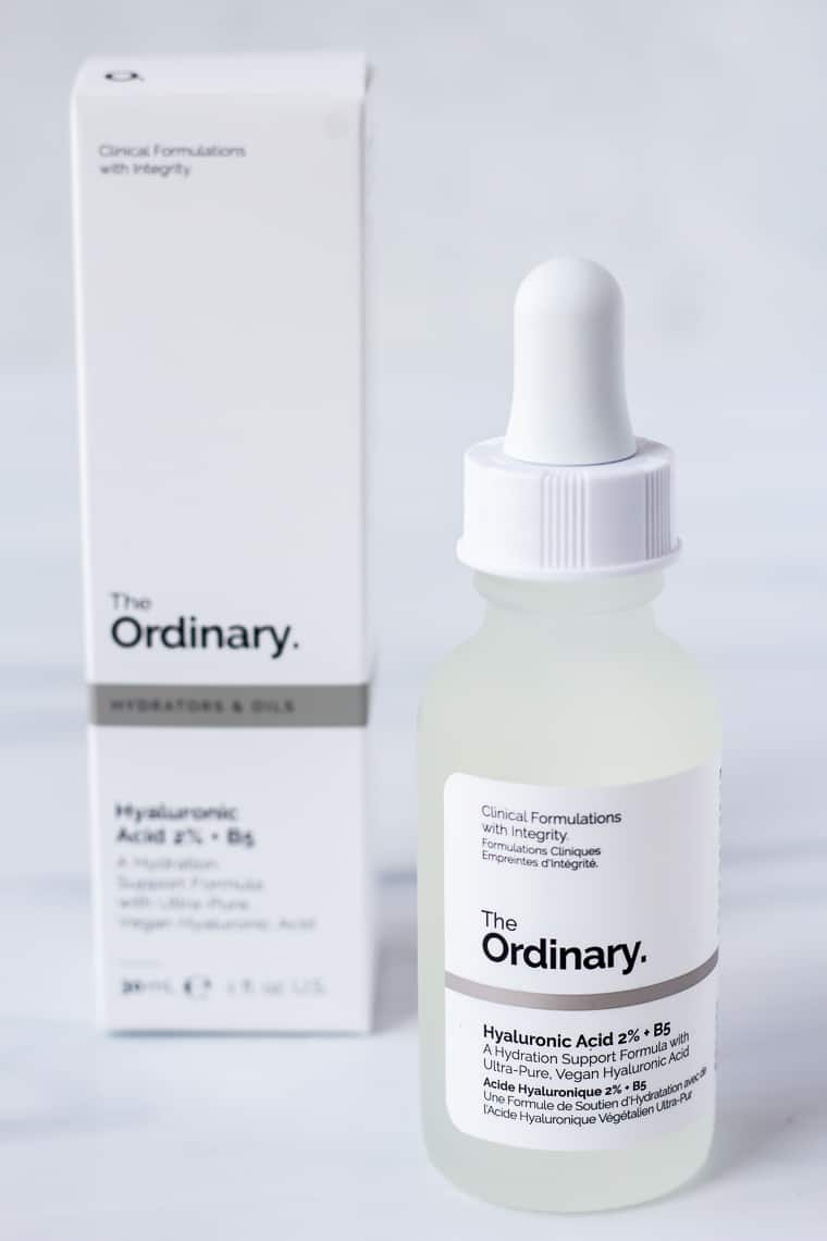 A bottle of The Ordinary Hyaluronic Acid 2% + B5 with the box behind it on a white background