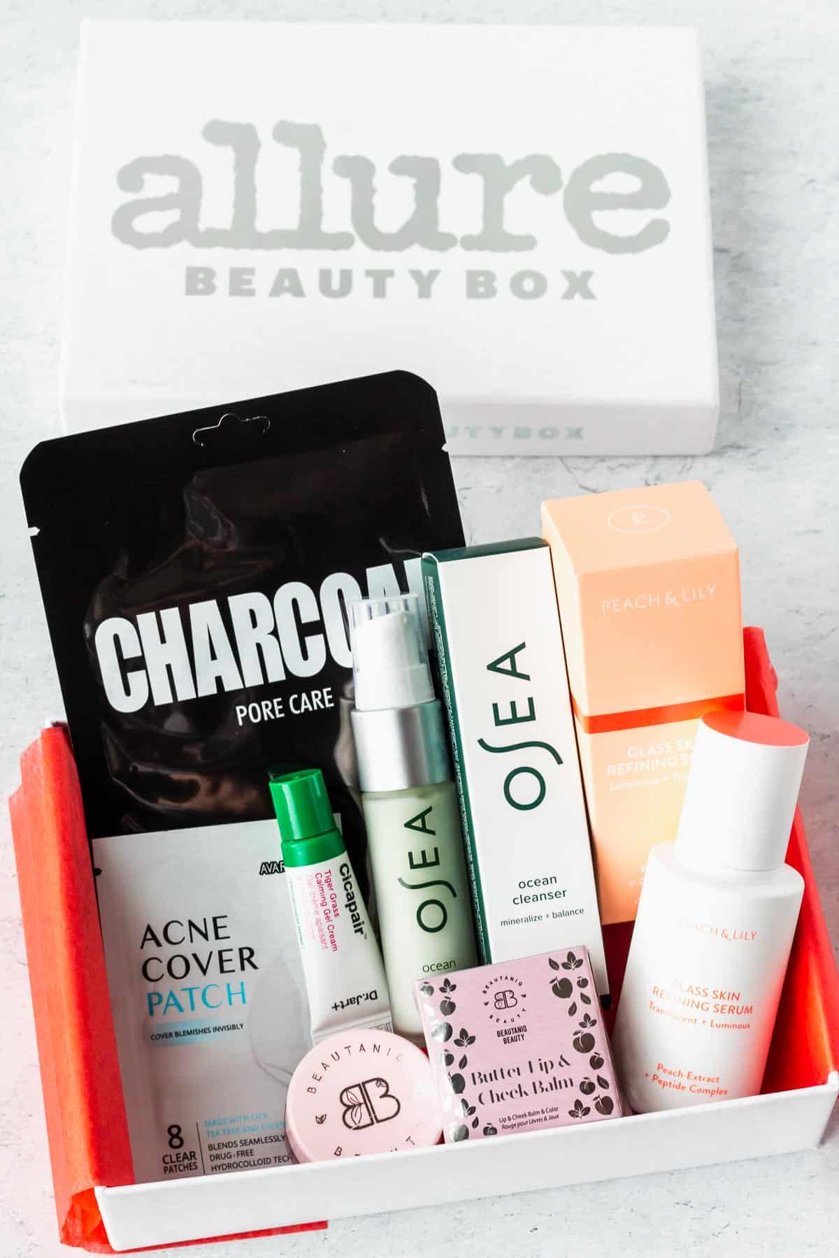 July 2020 Allure Beauty Box with all of the contents displayed inside