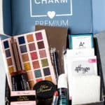 August 2020 Boxycharm Premium box items in a box with text overlay