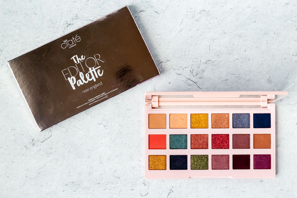Ciate London New England Editor Palette box and opened eyeshadow palette on a white background