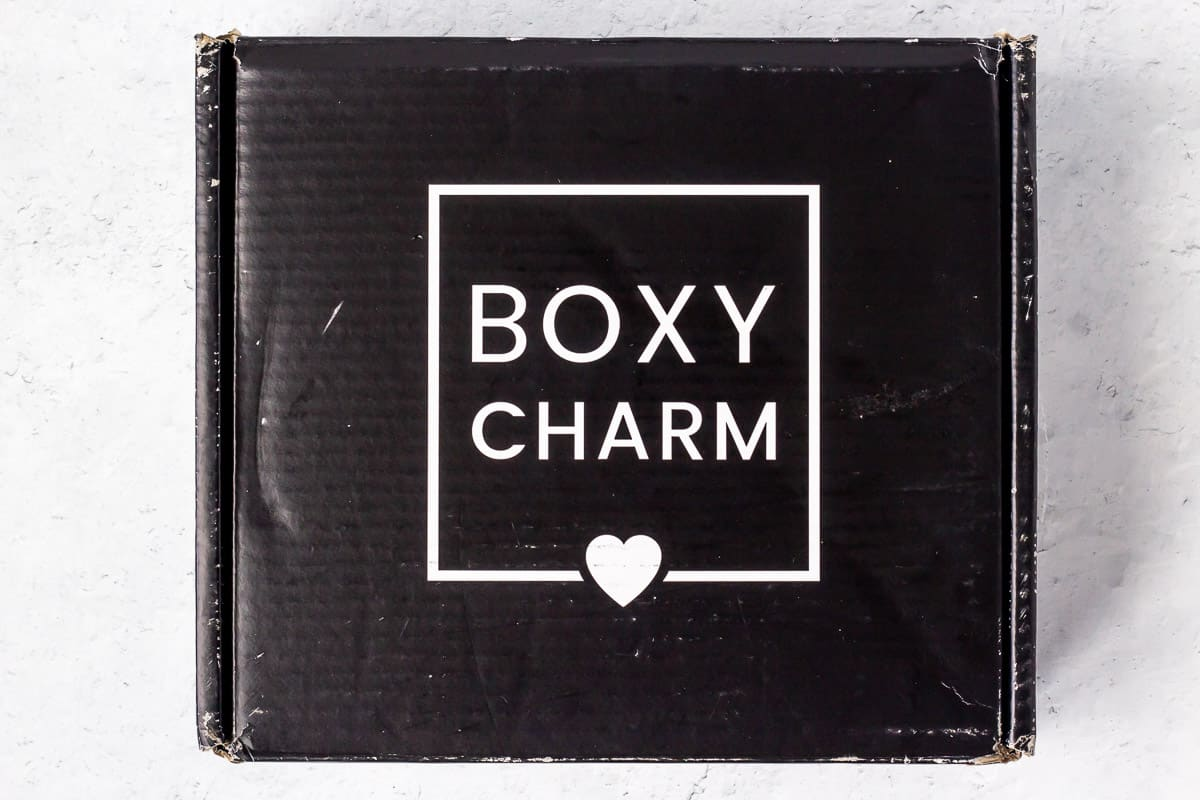 The august 2020 Boxycharm Premium box unopened on a white background