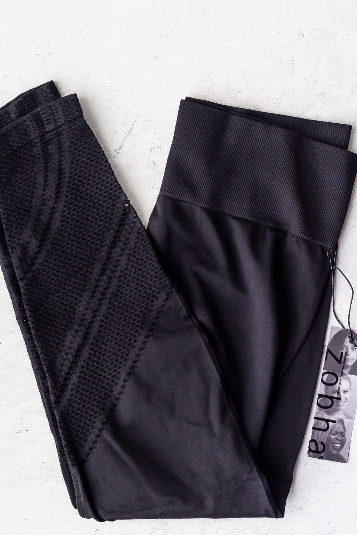 Black leggings folded on a white background