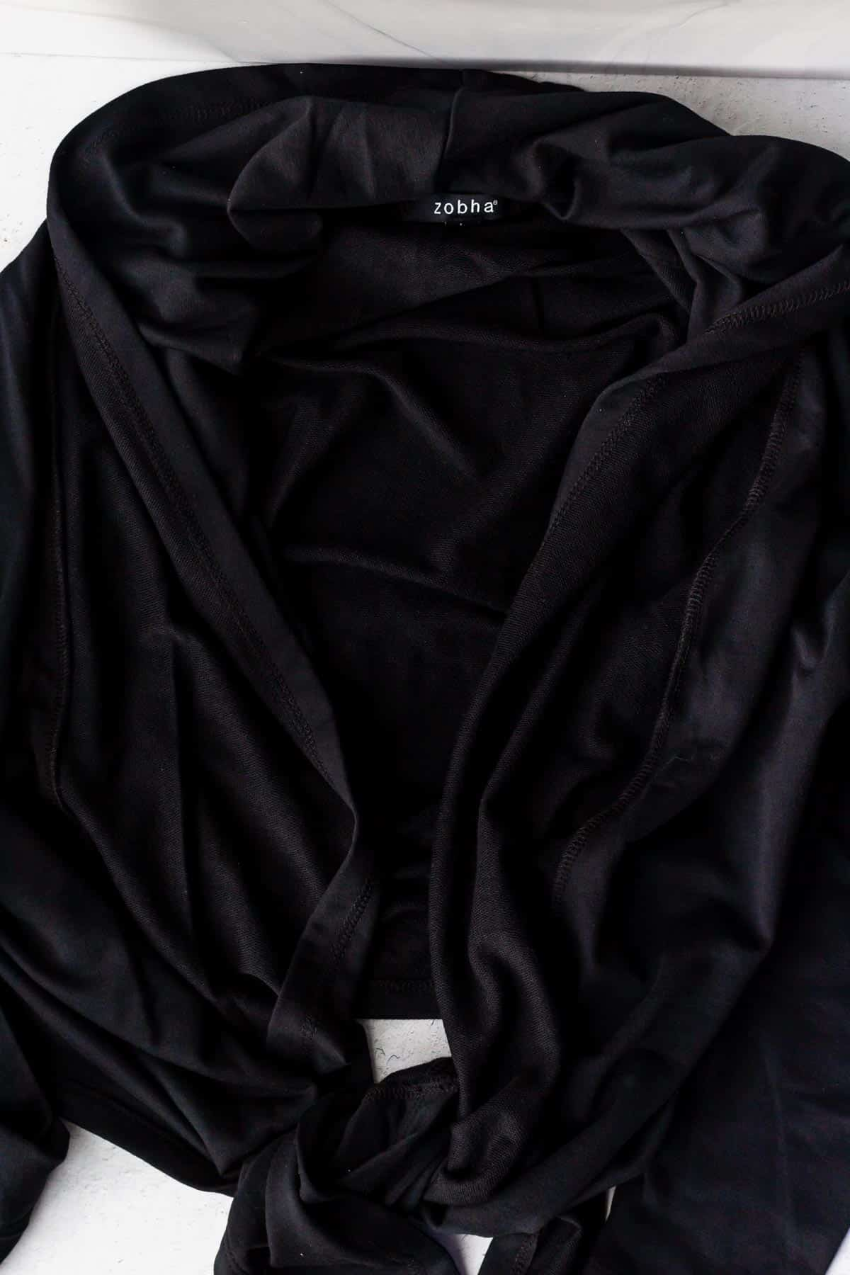 Black tie front cardigan on a white background