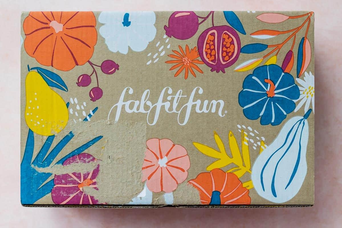 The Fall 2020 FabFitFun box on a peach background