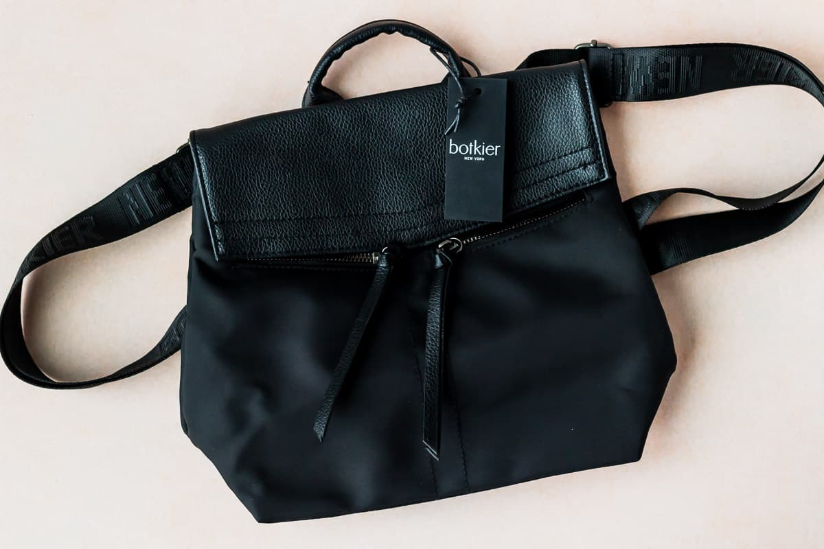 Botkier Trigger Backpack on a peach background