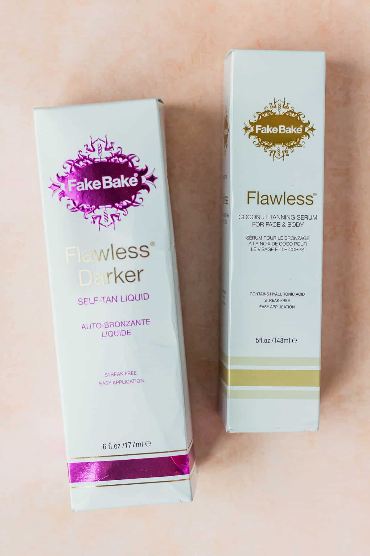2 FakeBake Tanning lotion packages on a peach background