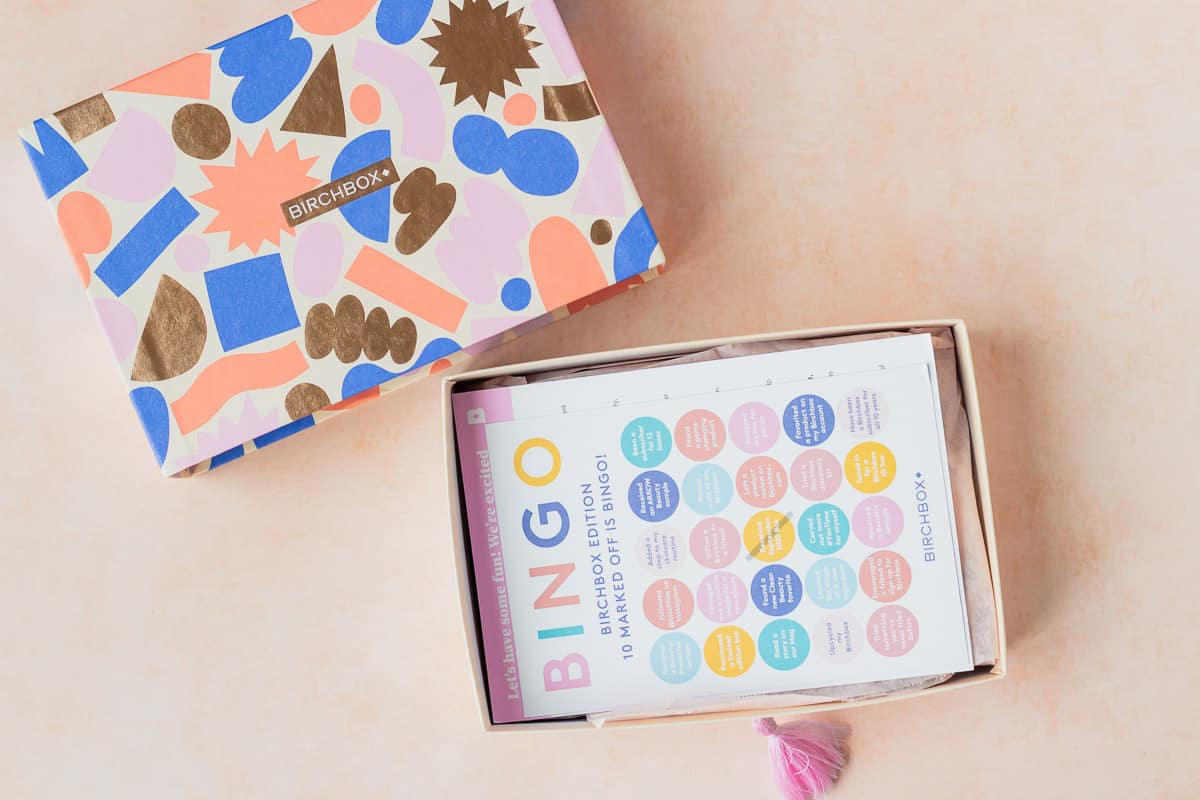 An opened september 2020 birchbox with the insert card on top of the items in the box
