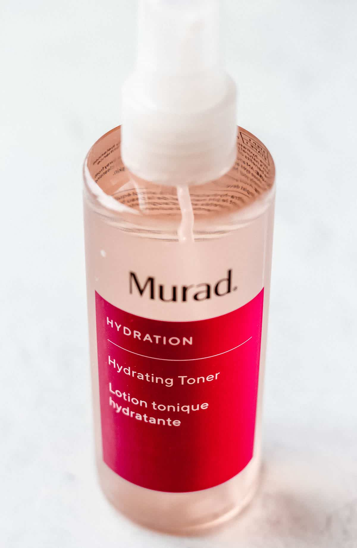 Murad hydrating toner on a white background