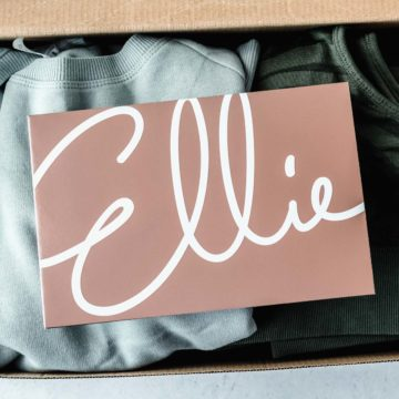 Ellie insert card on top of clothes in a box
