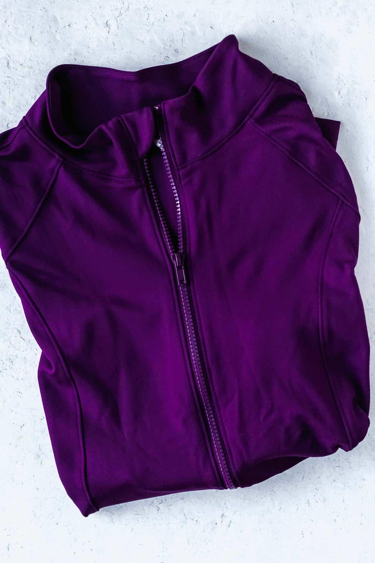 purple marika mabel jackets folded on a white background