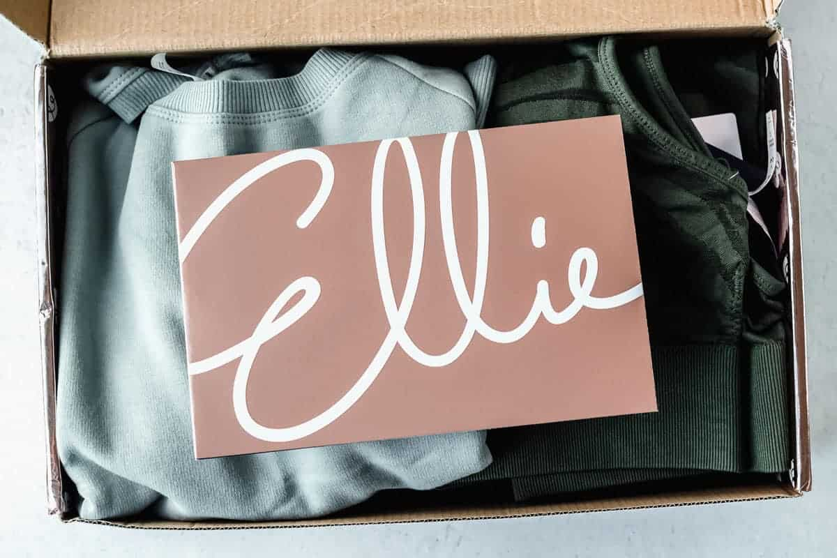 Opened Ellie activewear box with items inside and an insert card on top of them