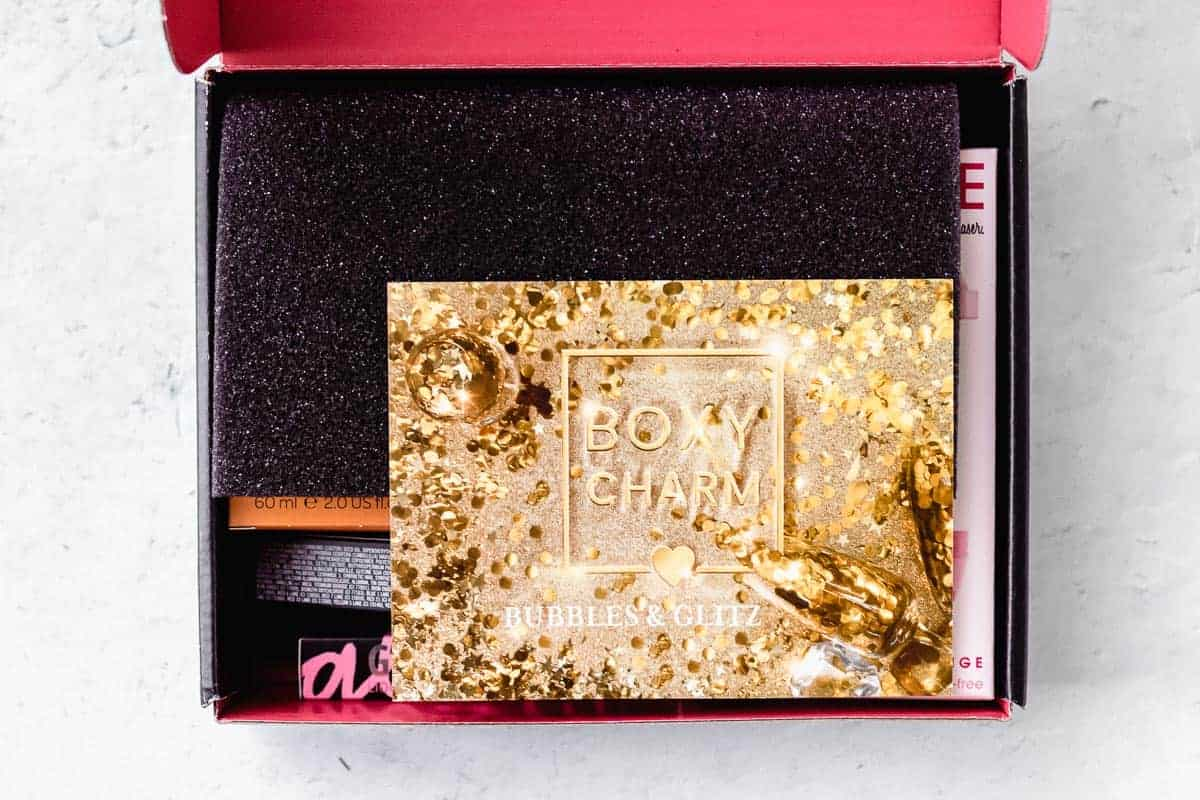 the december 2020 boxycharm box opened on a white background with the insert card on top