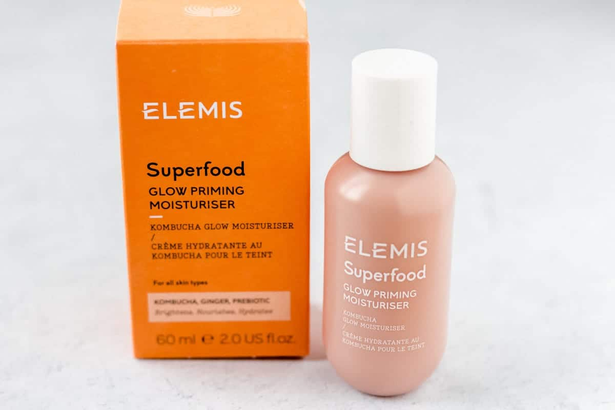 Elemix superfood glow priming moisturizer bottle and package on a white background