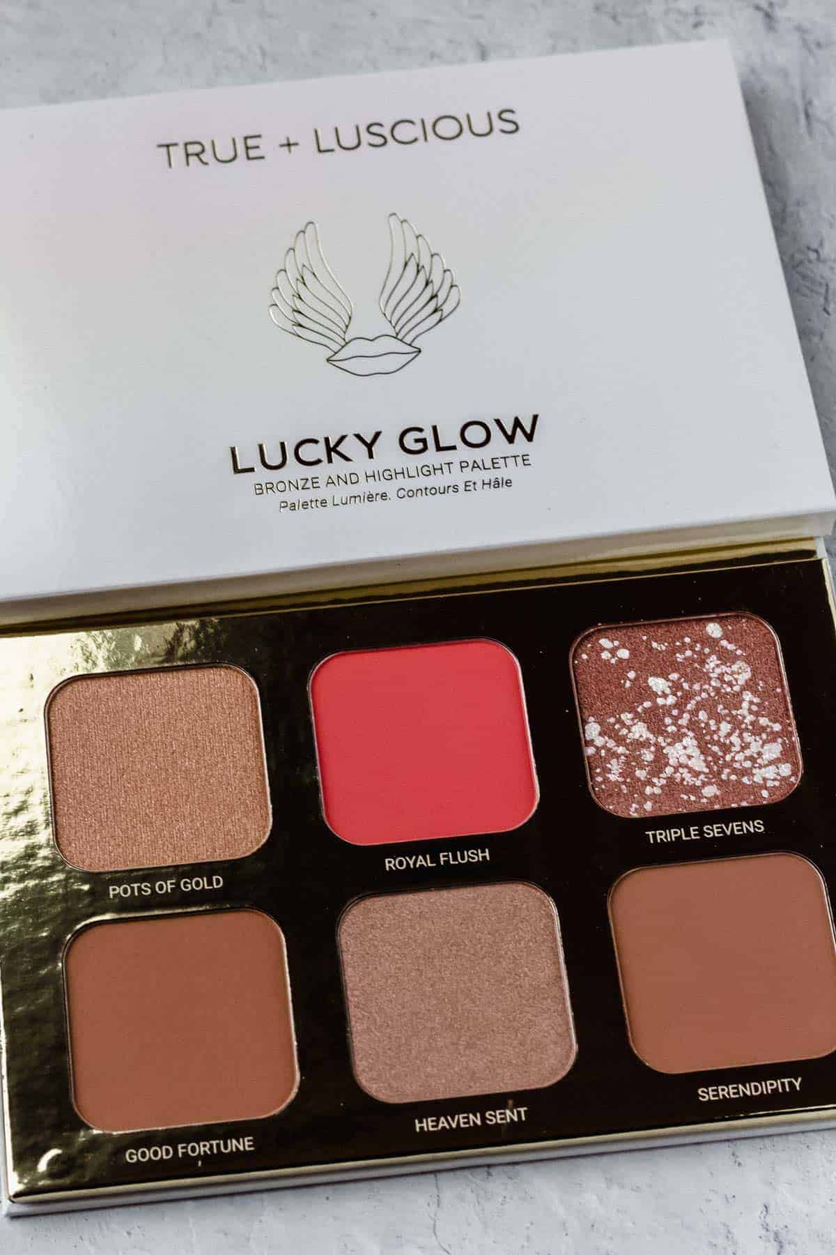 Lucky glow bronzer and highlighter palette on a white background
