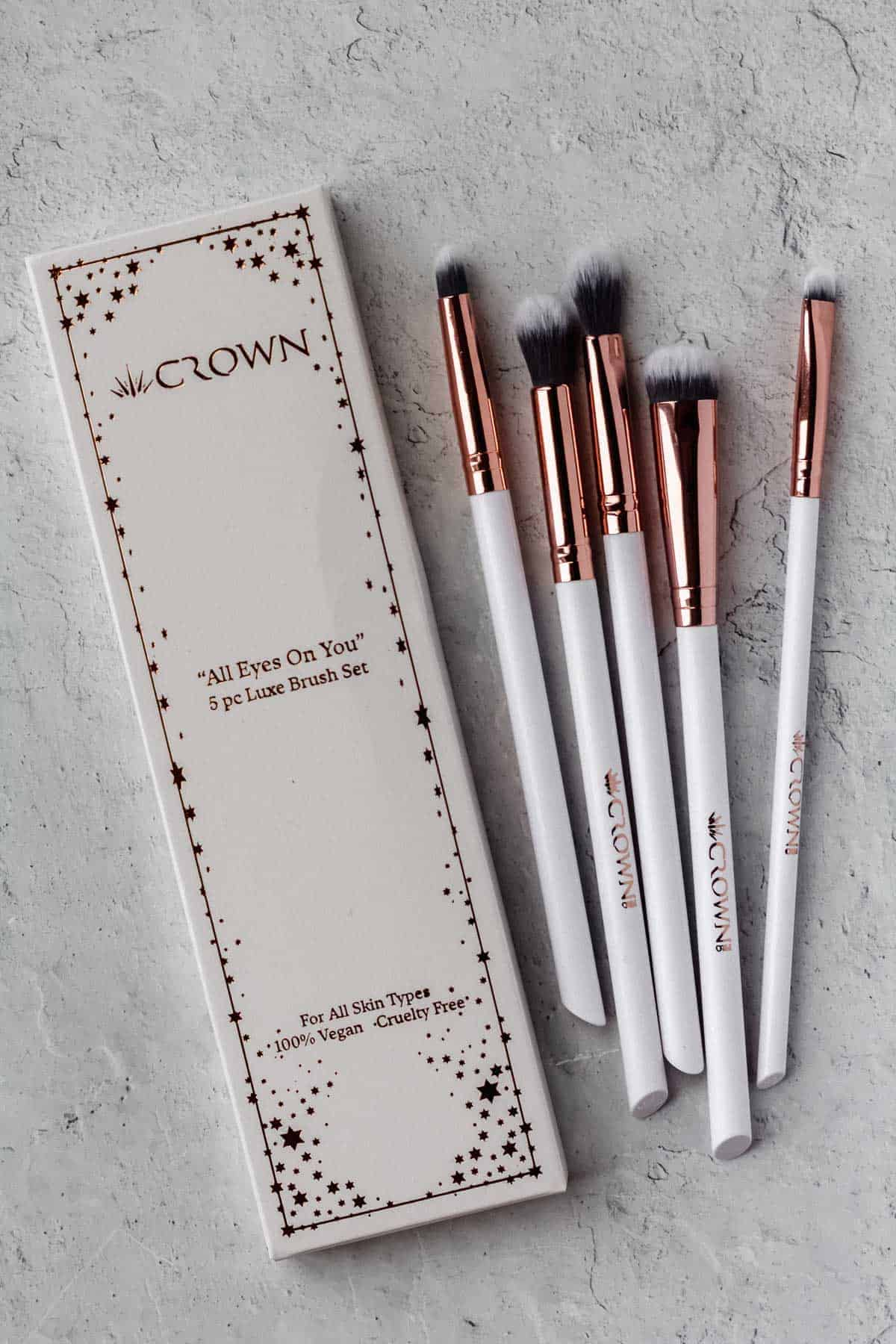 Crown eyeshadow brush set and box on a white background