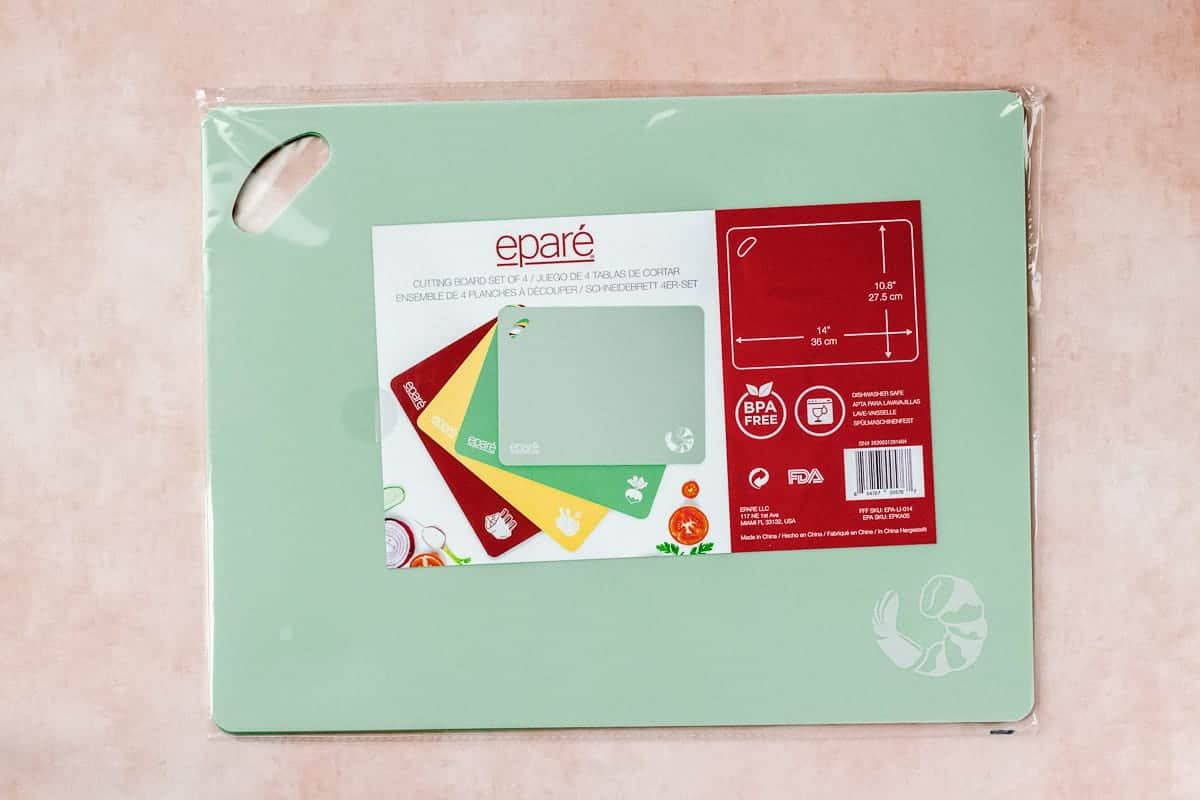 epare cutting board set on a peach background