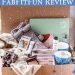 Items from the winter 2020 fabfitfun box displayed inside of the box with text overlay