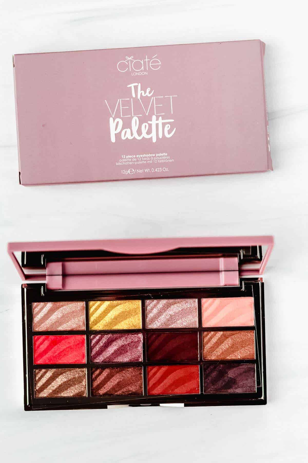 Ciaté London Velvet Eyeshadow Palette opened with the box behind it on a white backdrop
