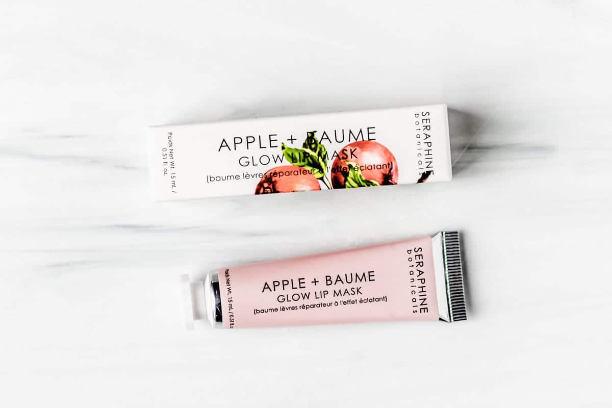 Seraphine Botanicals Apple + Baume Glow Lip Mask tube and box on a white backdrop