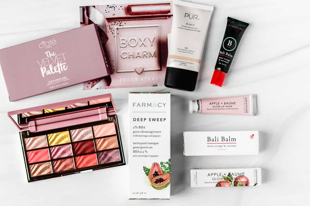 All of the items from my january 2021 boxycharm base box laid out on a white backdrop