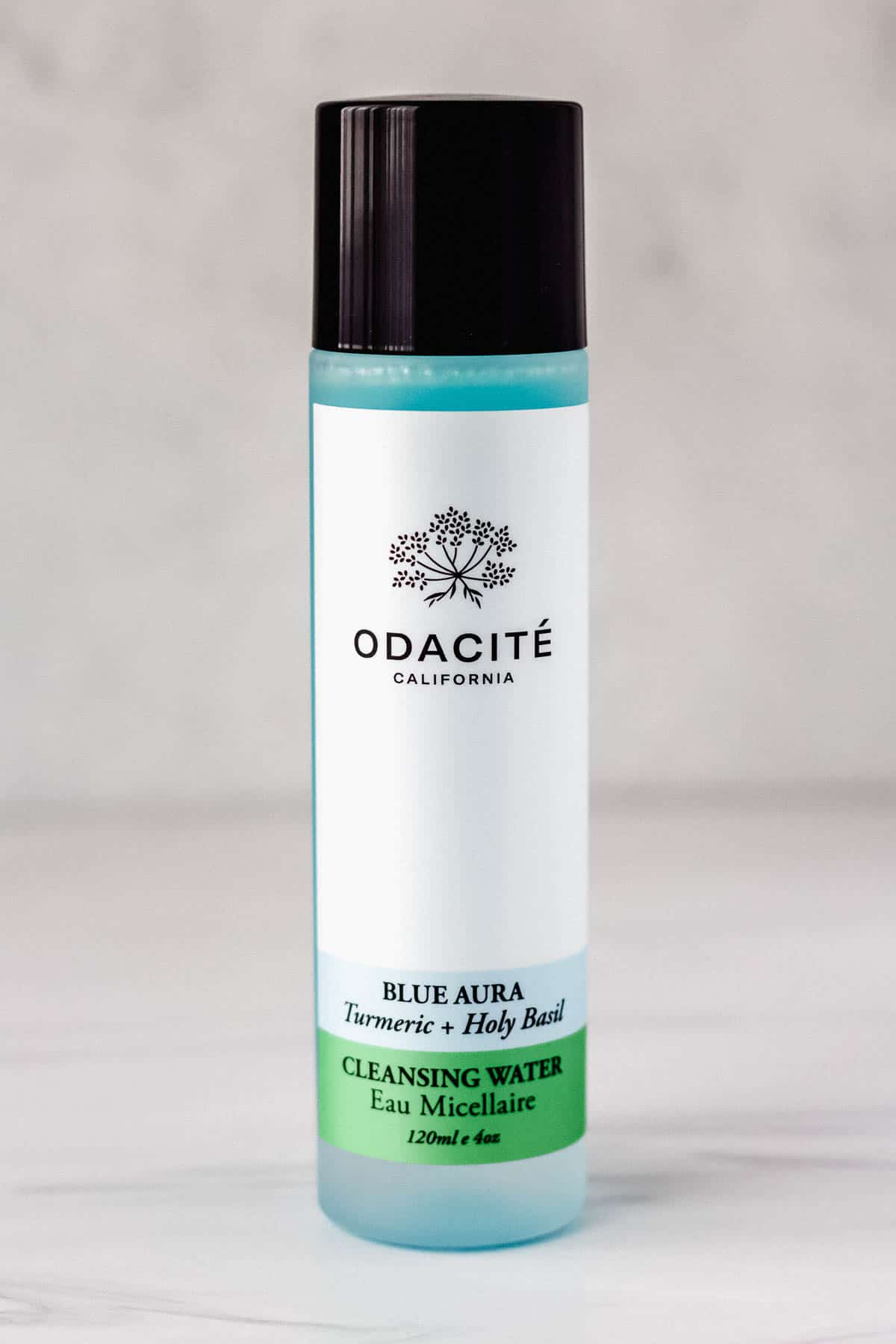Odacite Blue Aura Cleansing Water jar on a gray background