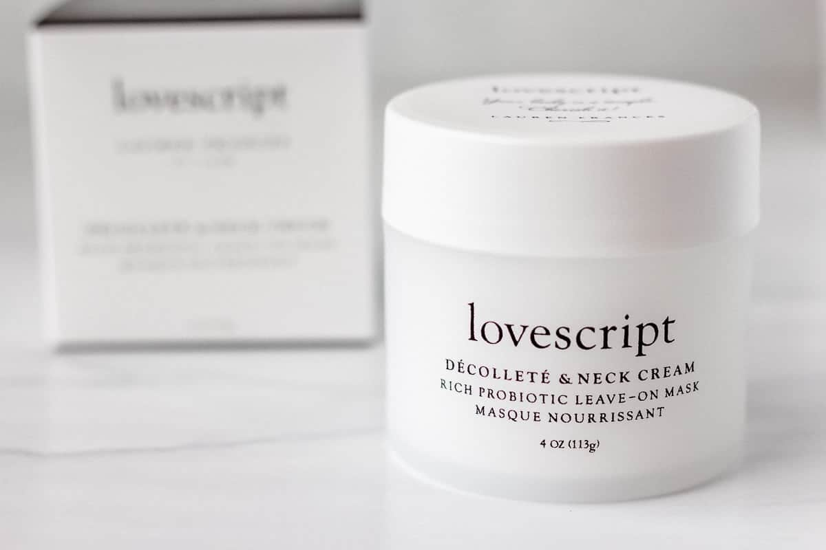 Lovescript Décolleté & Neck Cream Leave-on Mask jar and box on a gray background