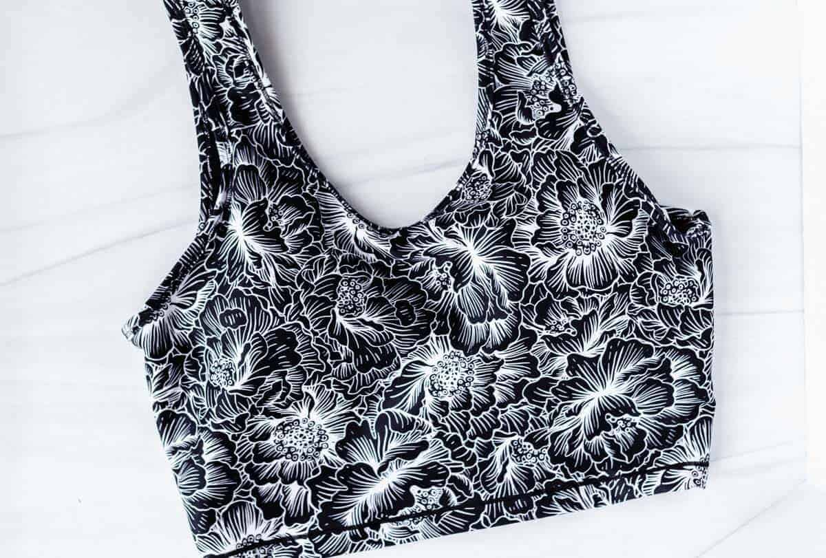 Marika Layla Sports Bra with black and white floral print on a white background