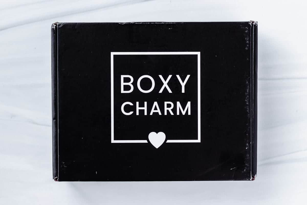 March 2021 Boxycharm Base Box closed on a white background