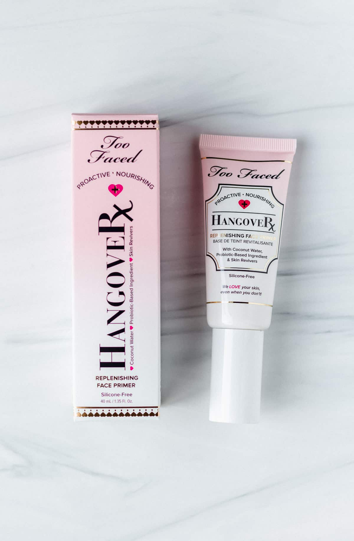 Too faced hangover primer box and tube on a white background