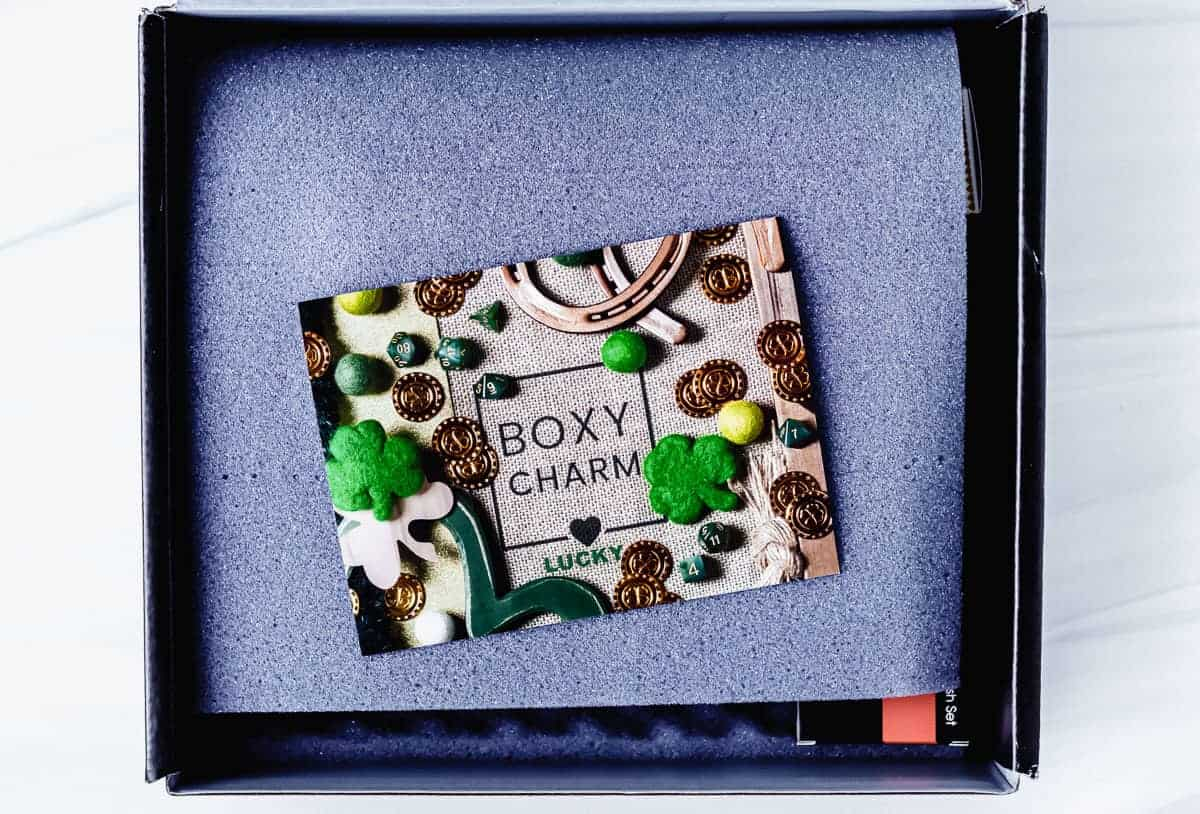Opened march 2021 boxycharm premium box with foam and insert card on top
