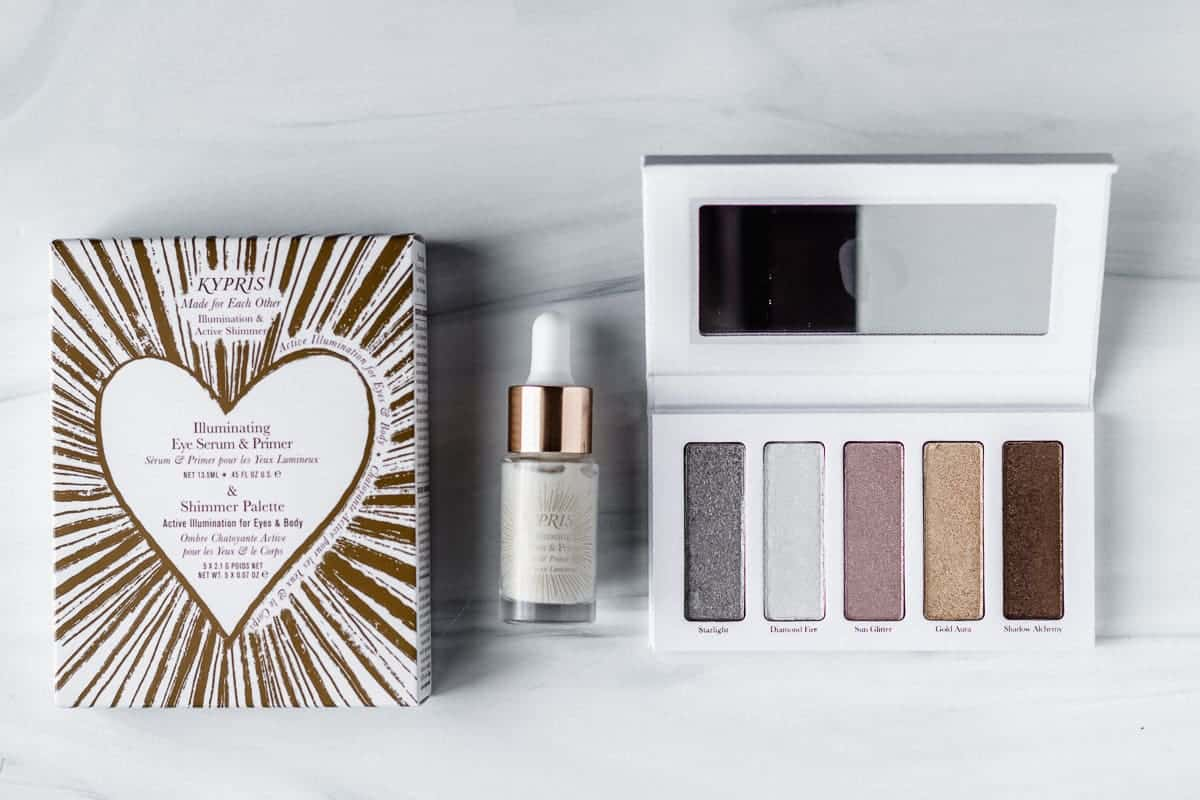 Kypris illuminating eye serum and primer and palette on a white background