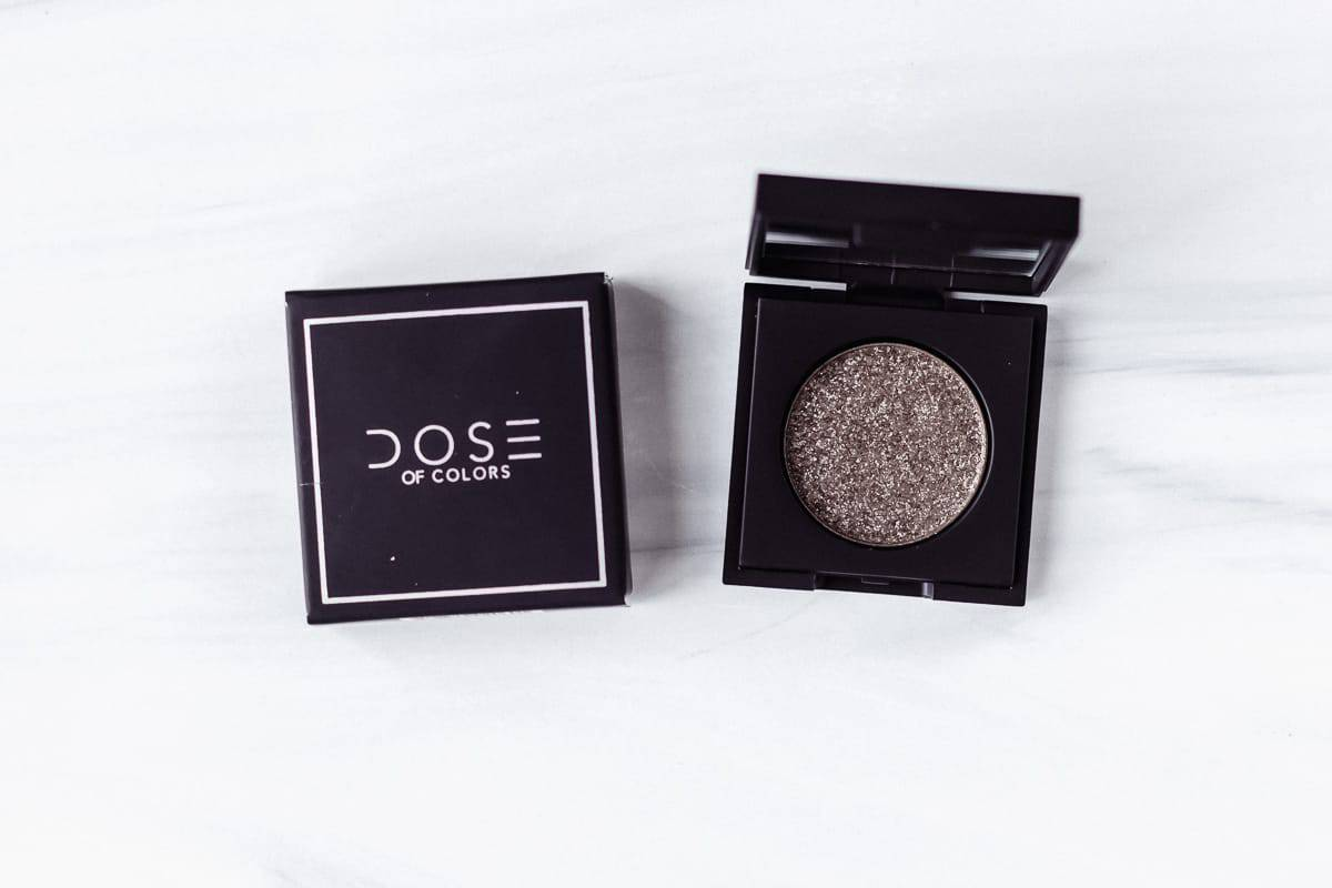 Dose of Colors Block Party Single Eyeshadow in Refelction and its box on a white background