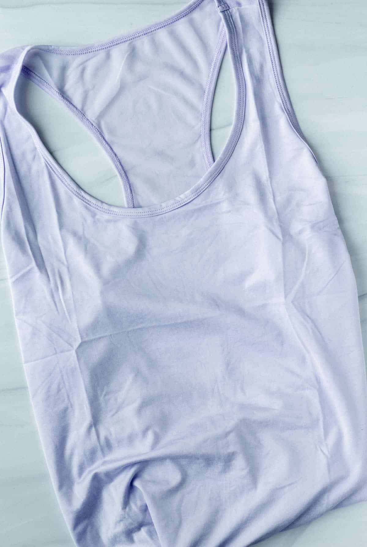 Jessica Simpson Excel Active Tank in lavender on a white background