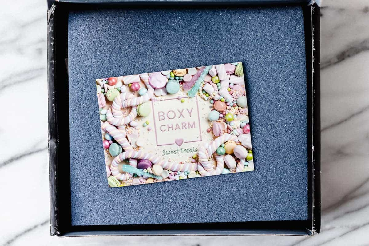 Opened april 2021 boxycharm premium box with foam and insert card on top